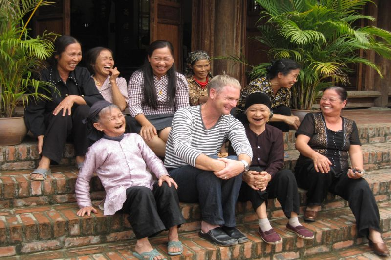 Chatting with local people in Hanoi